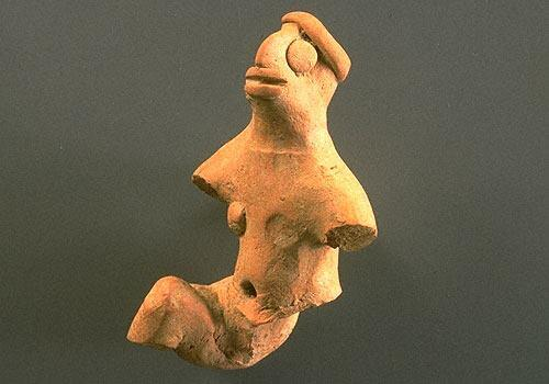 A few male figurines demonstrate unusual postures such as one with one leg extended forward and the other extended behind. Male figurines also sometimes wear a simple headband around the top of the head. Approximate dimensions (W x H x D): 4.3 x 7.2 x 3.2 cm.