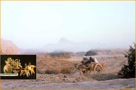 """Early morning mist at Mohenjo-daro with the Buddhist stupa perched on top of the """"citadel"""" mound."""
