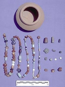 The small Late Harappan Period Pot yielded 133 beads & other decorative objects. Although left behind by a bead collector at almost 1700 BC, the wide variety of beads & other objects found inside the pot belong to all periods of Harappan occupation. In addition to carnelian & faience beads (the most numerous), the vessel contained what we first thought was a red-brown glass bead. Analysis conducted by Robert Brill (and colleagues) at Corning Museum of Glass determined it isn't glass, but crystalline rock.