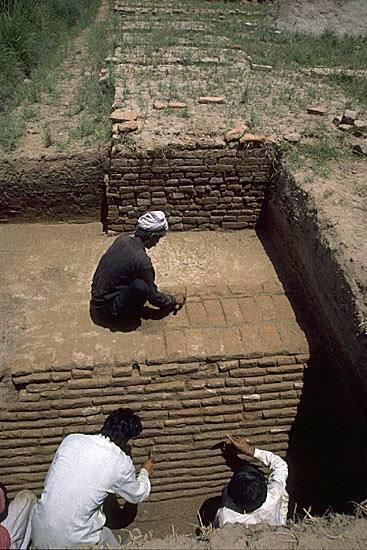 "A massive baked brick revetment wall surrounds the solid mud-brick foundation platform of the ""granary"" that measures approximately 51 meters north-south and 41 meters east-west. Based on analysis of the pottery and other finds from below and against the revetment wall, it is possible to date its construction to near the end of Harappa Period 3B, between 2300 and 2200 BCE."