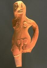 Other male figurines stand with their hands on their hips and their legs pressed together, a common posture for female figurines. Approximate dimensions (W x H x D): 4.0 x 9.7 x 2.8 cm.