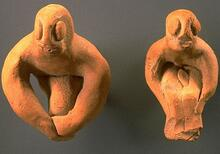 Most male figurines from Harappa sit with knees bent and arms at the sides of the legs or around the knees. Some of these figurines have facial features and even genitalia, and a few have stylized legs joined into a single projection.