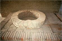 This unique well and associated bathing platform was discovered in the course of building a catchment drain around the site. It was reconstructed on the ground floor of Mohenjo-daro site museum.