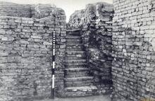 """""""A flight of eights steps on the west side of Courtyard 6 leads up to Well No. I (Plate XLIII, b [shown]). This well, 3 ft. 5 in. in diameter, and lined with well-burnt, wedge-shaped bricks, was cleared to a depth of 41 feet, when 4 feet of water was obtained."""" (H. Hargreaves, HR Area,p. 179 in Marshall, Mohenjo-daro, p. 179)."""