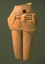 "The multiple-strand belt on some of the female figurines is often accompanied by a plain short ""skirt"". The applied decorations on the belt may represent beads or other decorations. Approximate dimensions (W x H x D): 3.8 x 7.3 x 2.0 cm. (Photograph by Richard H. Meadow)"