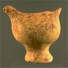 "Among the most convincing cases for figurines as toys are the hollow bird figurines that have a hole either on the back near the tail or in front of the torso that allowed them to be used as whistles. Similar terracotta ""bird whistles"" are still found in South Asia. Approximate dimensions (W x H(L) x D): 3.8 x 5.5 x 5.3 cm. Photograph by Richard H. Meadow."