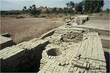 This well was associated with a finely constructed bathing platform. A stairway leads up to the well and platform from a lower room. The walls and well have been covered with mud brick and sprayed with clay slurry to protect them from salt crystallization.