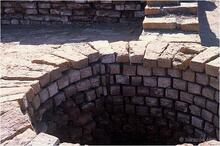 Wells were made with wedge shaped bricks to make a strong circular structure. Some bricks were made with special grooves to keep the ropes from sliding sideways when drawing water.