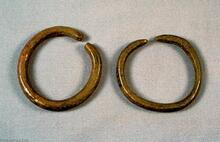 The bangles were made from a round hammered rod bent in a full circle. The space between the ends of the bangle would be pried apart to slip it over the wrist.