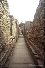 HR Area, Lane 2, looking east with Block 2 on the left (late 1920s). The streets and alleyways wind through the neighborhood and are usually oriented along a strict grid plan, one of the most remarkable features of this four and half thousand year old city.