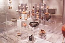 Pottery by Sherezade Alam displayed within acrylic swastika structure, Swastika Gallery
